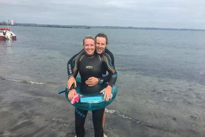 Aimee and her partner after she completed her 5km ocean swim